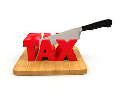 knife cutting the word tax