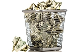 Waste bin full of money