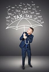 man holding umbrella from falling taxes
