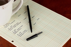 Spreadsheet, coffee mug and pen on a desk