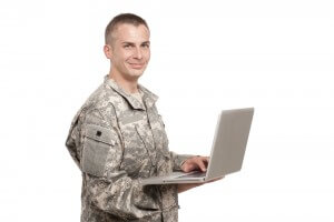 veteran holding laptop
