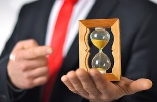 man holding hourglass
