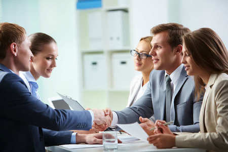 A group of employees siting together having a meeting
