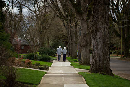 Couple walking on sidewalk