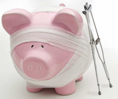 Piggy bank wrapped in bandages