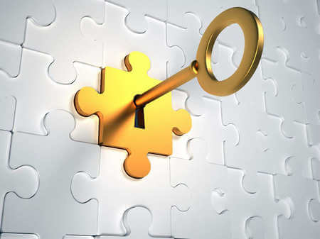 White puzzle piece with a gold one in the middle with a key
