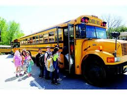 kids getting onto schoolbus