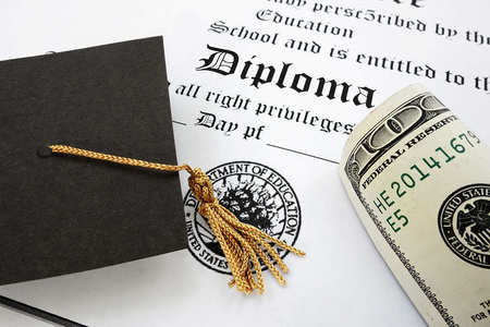 College graduation cap and money on top of a diploma