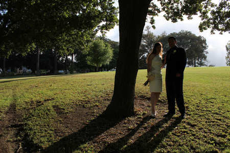 Couple standing under tree