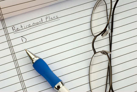 glasses on pad of paper with retirement plans